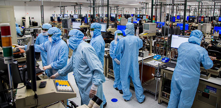 Workers at right in Finisar's wafer testing area. Apple has committed to buy $390 million of VCSELs from the photonics company. Credit:Finisar/Apple