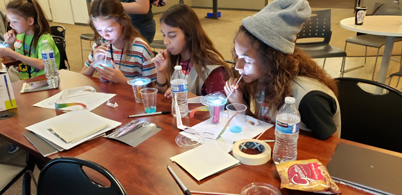 Girls get an introduction to thin film interference while having fun with bubbles