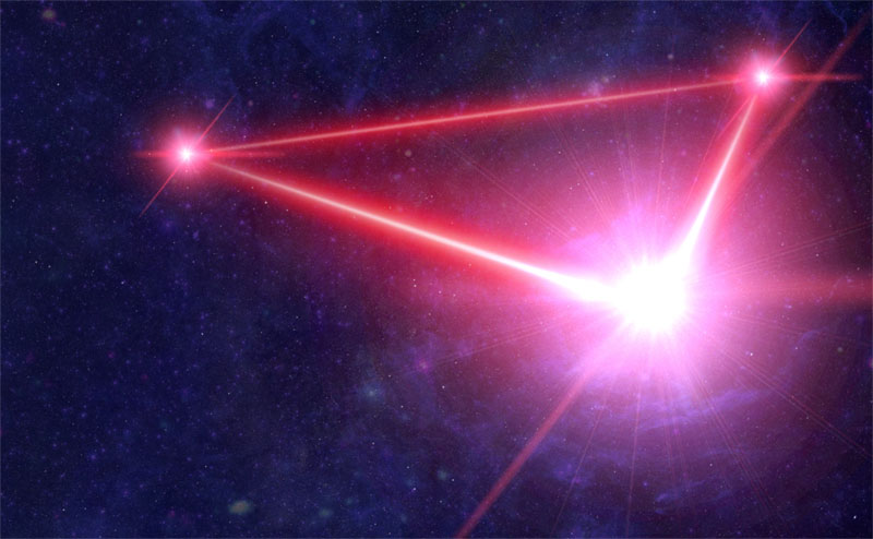 Artist's impression of the LISA constellation with three spacecraft connected by laser links.