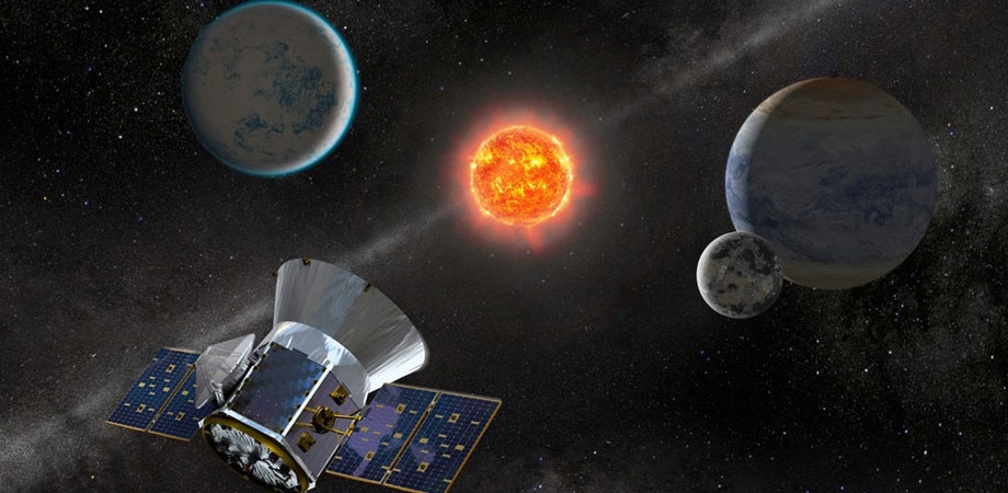 Artist concept of TESS observing an M dwarf star with orbiting planets.