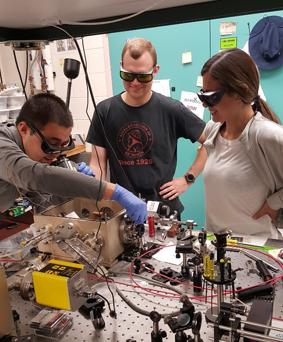 Junwei and colleagues working in the UNM lab